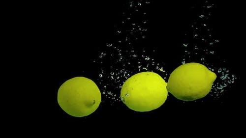 Lemons in Slow Motion in the Water