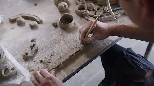 Thumbnail for Male Potter Hands Working with Clay