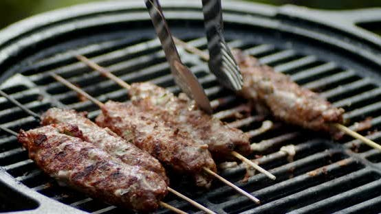 Thumbnail for Kebab on a Stick Turned on the Grill.