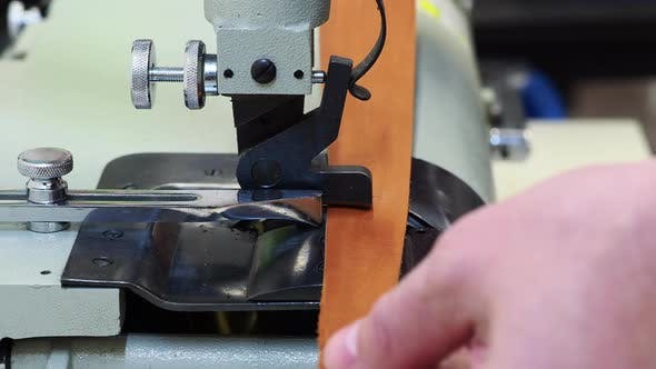 Thumbnail for Man Works on Leather Skiving Machine
