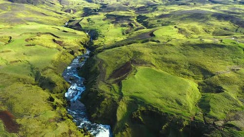 Flying Over the Wild Mountain Skogar River Under the Eyjafjallajokull Volcano in Southern Iceland