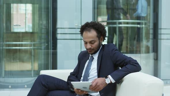 Thumbnail for Middle Eastern Entrepreneur Using Tablet in Business Center