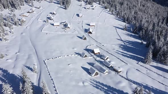 Flying Above Snow Buried Ranch Huts