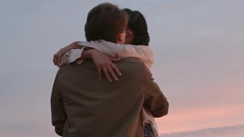 Romantic Kiss at Sunset