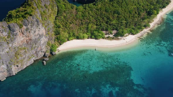 Thumbnail for Aerial Circle Fly Over Tropical Beach on Dilumacad or Helicopter Island. El Nido, Palawan