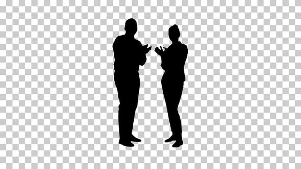 Thumbnail for Silhouette One businessman and one businesswoman applauding