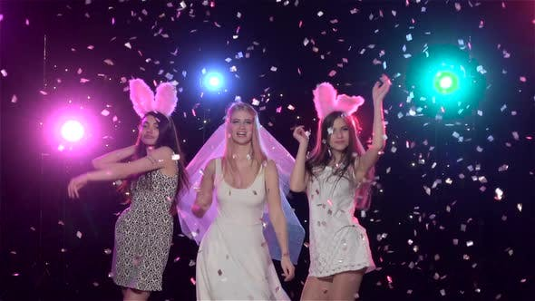 Cover Image for Girls Dancing at Bachelorette Party Against Stroboscope Lamps, Slow Motion