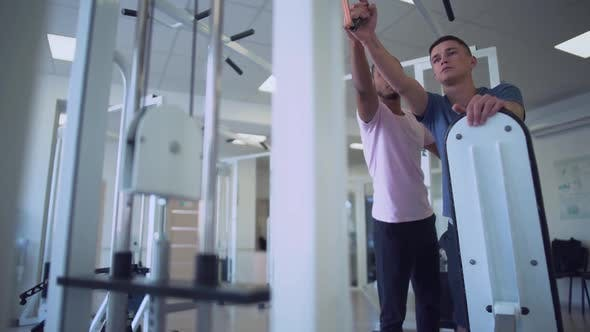 Thumbnail for Young Male Is Doing Strength Exercises in the Gym People in the Gym Healthy Lifestyle