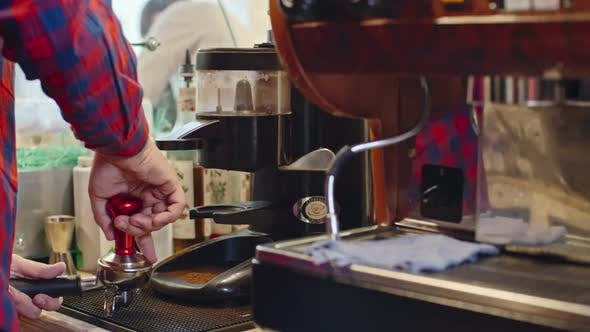 Thumbnail for Barista Pressing Ground Coffee