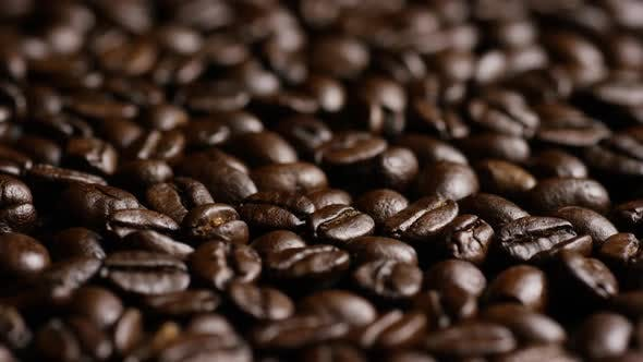 Thumbnail for Rotating shot of delicious, roasted coffee beans on a white surface - COFFEE BEANS
