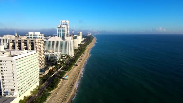 Aerial Footage above the sea viewing the Miami beach