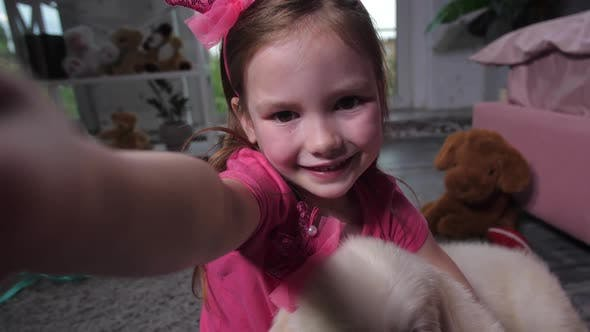 Thumbnail for Portrait of Child Taking Selfie with Puppy at Home