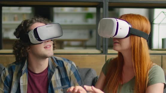Thumbnail for Young Couple Wears VR Headset at Home, Enjoying VR Images