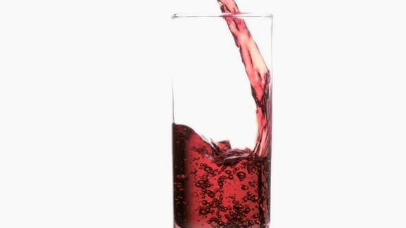Thumbnail for Trickle of red liquid in super slow motion flowing in a glass