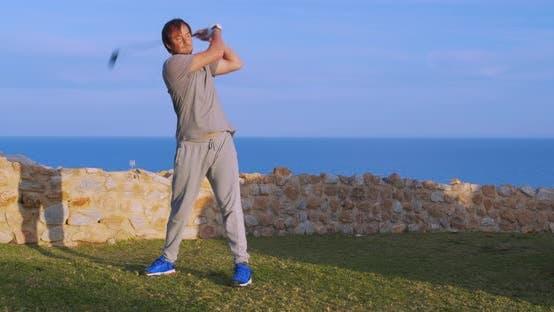 Man Golfer in Sunset Enjoying Vacation on Luxury Resort.