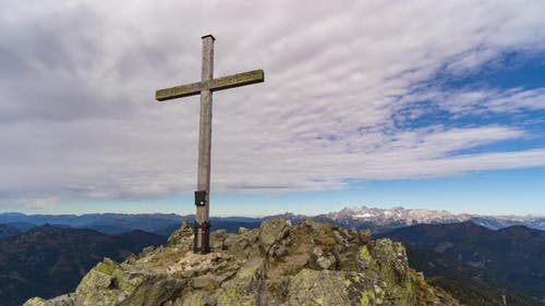 Time Lapse Clouds Pass Over Mountain Summit Cross