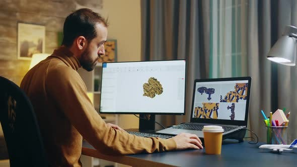 Thumbnail for Bearded Engineer Taking a Sip of Coffee While Working on Computer