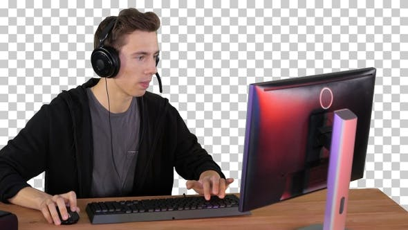 Gamer guy in headphones playing video, Alpha Channel