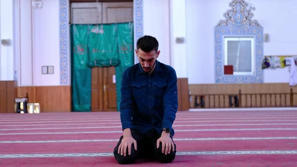 Youth Turning Head in Mosque