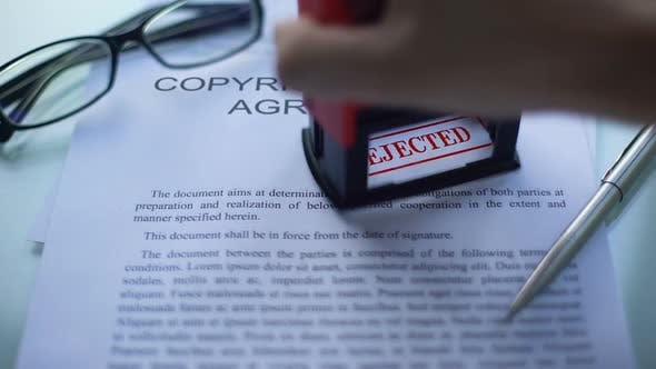 Thumbnail for Copyright License Agreement Rejected, Officials Hand Stamping Seal on Document