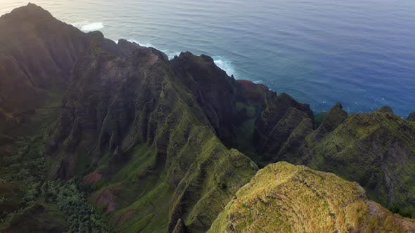 Thumbnail for Grassy Rocks of Mountainous Coastal Terrain of Hawaii Illuminated By Sunset Light. Aerial Shot