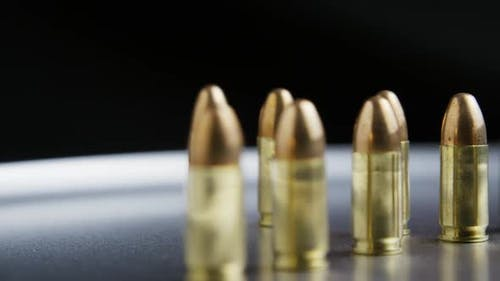 Cinematic rotating shot of bullets on a metallic surface - BULLETS 032