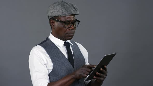 Stylish African Man Using Digital Tablet
