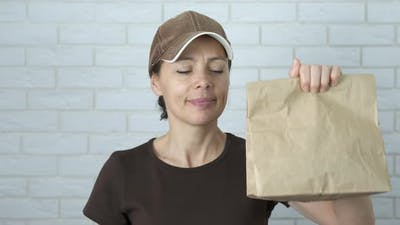 Woman with Food Bag Delivery