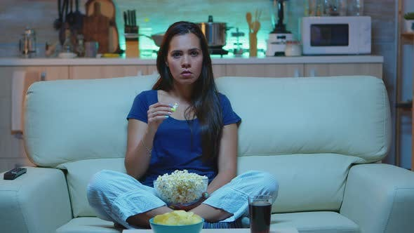 Person Holding Pop Corn Bowl Watching Movie
