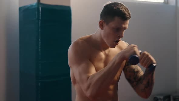 Young Boxer with Tattoos Training in Gym, Slow Motion