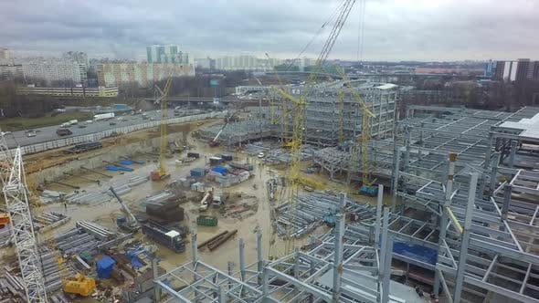 Thumbnail for An Aerial View of a Large Construction Site Next To a Busy Highway