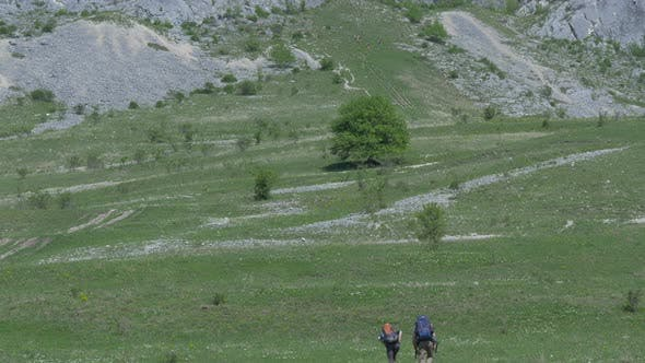 Thumbnail for Couple hiking towards Piatra Secuiului