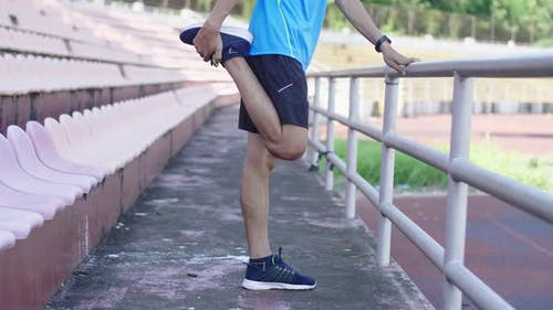 Athlete Stretching Legs