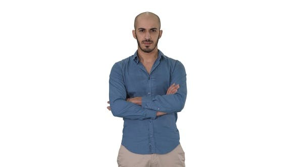 Serious Confident Arabian Man in Casual Folds Hands Looking