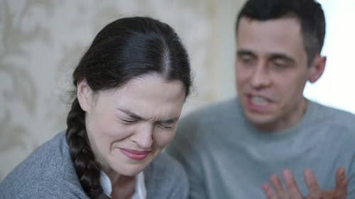 A Man Yells at a Woman Who is Crying