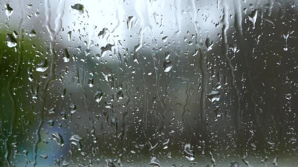 Heavy Rain Drops On Window Glass