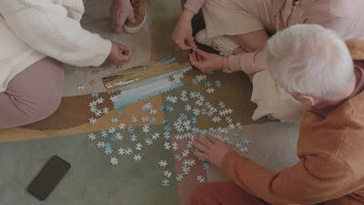 Assembling Puzzle on Floor