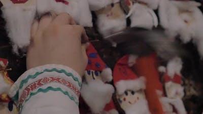 Placing Santa Claus craftwork into Christmas collection