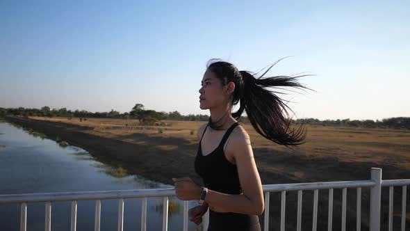 Young women exercise by running