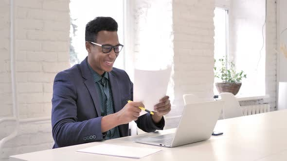 Thumbnail for Businessman Celebrating Success While Reading Documents in Office