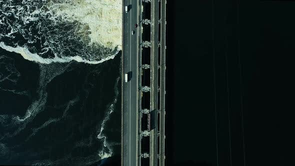 Thumbnail for Aerial View of the Bridge Over the River, the Dam. Bubbling Waves on the Water, a Beautiful