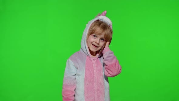 Thumbnail for Little Kid Girl Daughter in Unicorn Pajamas Using Speaking Talking on Mobile Cell Phone with Mother