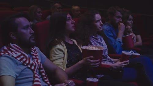 People Watching Thriller at Cinema
