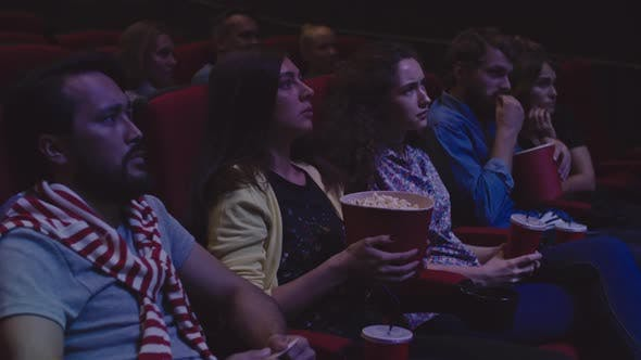 Cover Image for People Watching Thriller at Cinema