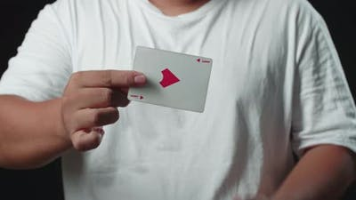 Magician Showing His Trick With Usual Cards, Change Card