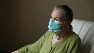Old Woman in Face Mask on Quarantine