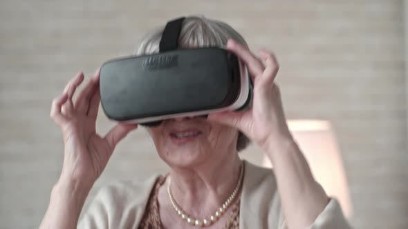 Thumbnail for Old Woman Jumping in VR Glasses