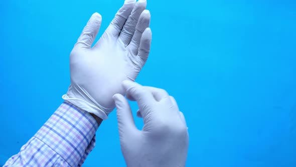 Thumbnail for Doctor Hand with Glove on Blue Background.