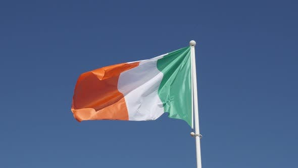 Thumbnail for Irish tricolour flag fabric waving on the wind on flagpole 4K 2160 30fps UHD footage - National symb