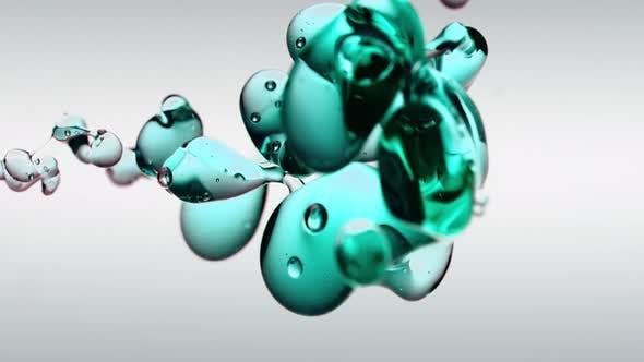 Thumbnail for Transparente Kosmetik Türkis Öl Blasen und Formen auf weißem Hintergrund